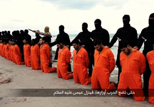 Jihadis from Isil with captured Egyptians who were murdered on a beach in Tripoli. Italy fears that Isil will use Libya as a springboard for a wave of attacks on Europe.