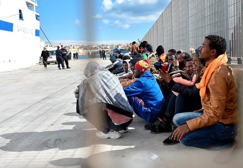 Immigrants wait to board a ship in Lampedusa, Italy. Hundreds of migrants have recently arrived in Lampedusa fleeing the attacks by ISIS in Libya.