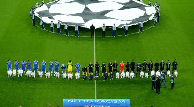 Chelsea and Schalke 04 players alongside a No To Racism banner prior to their Champions League clash in 2013. Photo: Lars Baron/Bongarts/Getty Images