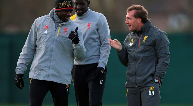 Liverpool manager Brendan Rodgers shares a joke with defenders Kolo Toure and Mamadou Sakho during a training session ahead of their Europa League clash with Besiktas. Photo: Nick Potts/PA Wire