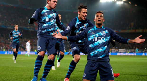 Danilo of celebrates with his teammates after scoring Porto's equalising goal in their Champions League round-of-16 clash with Basel and FC Porto at St Jakob-Park. Photo: Philipp Schmidli/Getty Images for UEFA