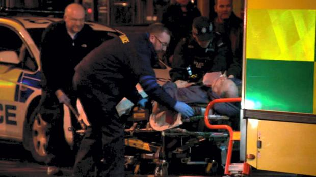 Derek Brockwell is put into an ambulance after he was tasered by PSNI officers outside the Bridge House Bar in Bedford Street. BBC Photo
