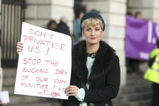 Emma Geraghty, 26, from Ballyfermot, a member of the Irish youth workers association at a protest by SIPTU members working in the community sector outside the Department of Environment, Community and Local Government yesterday.