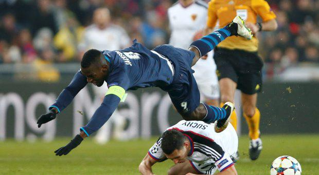 Porto's Jackson Martinez (top) falls over FC Basel's Marek Suchy during their Champions League round of 16 first leg soccer match in Basel, February 18, 2015