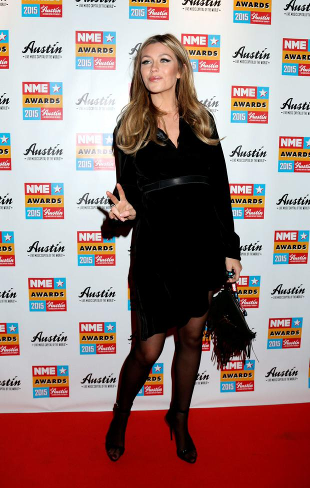 Abbey Clancy attending the NME Awards 2015 with Austin, Texas at the O2 Brixton Academy, London.