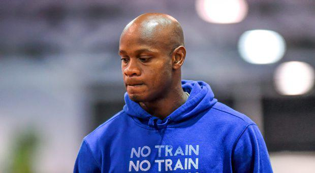 Asafa Powell of Jamaica after he pulled out of the AIT International Arena Grand Prix due to an injury picked up in his warm-up
