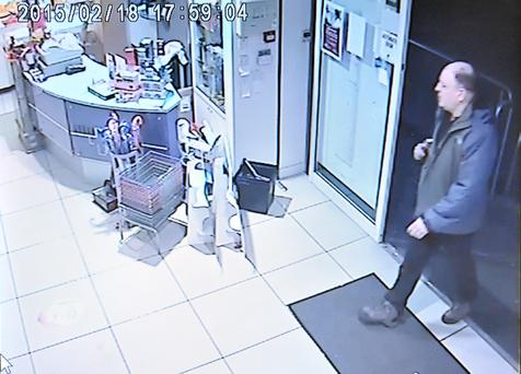 CCTV footage of a man matching the description of Derek Brockwell, walking into Urban Pharmacy on Belfast's Dublin Road (Picture by Justin Kernoghan)