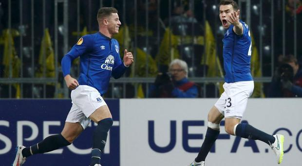 Everton's Seamus Coleman celebrates with team mate Ross Barkley after scoring a goal against BSC Young Boys during their Europa League round of 32 first leg soccer match in Bern