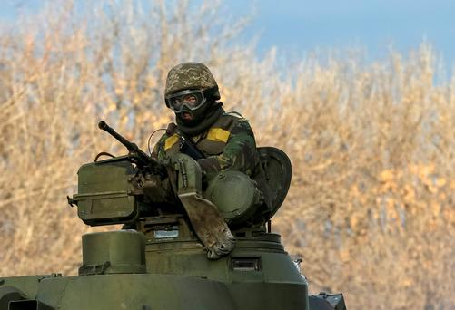 A Ukrainian serviceman rides on a self-propelled howitzer near Artemivsk February 19, 2015.