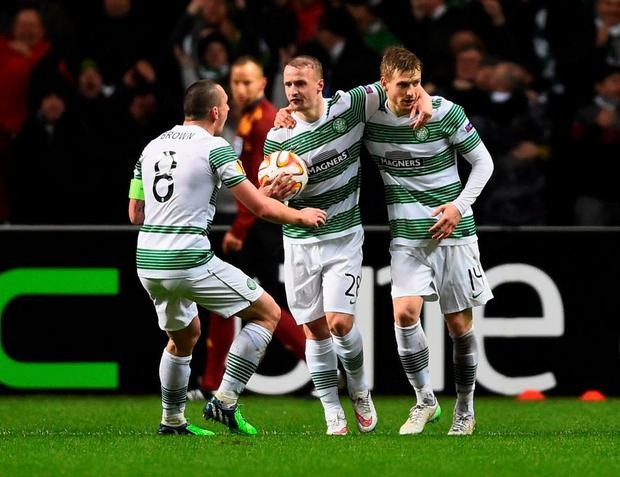 Stuart Armstrong celebrates with team mates Scott Brown and Leigh Griffiths as he scores their first goal during the UEFA Europa League Round of 32 first leg match between Celtic FC and FC Internazionale Milano at Celtic Park.