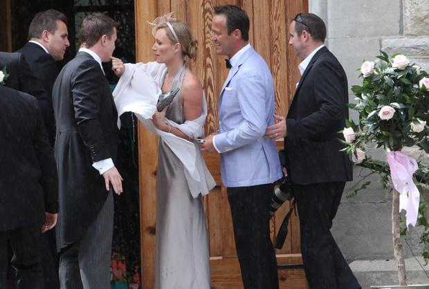 Victoria Smurfit and Doug Baxter with rugby star Brian O'Driscoll at his wedding to Amy Huberman. Photo: Gareth Chaney