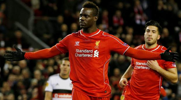 Mario Balotelli celebrates scoring Liverpool's winner from the penalty spot