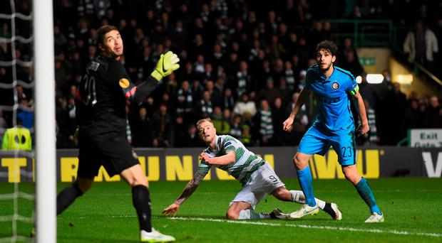 Celtic's John Guidetti looks on as his shot heads towards the net for a late equalising goal