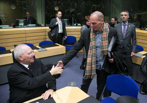 Greek Finance Minister Yanis Varoufakis (R) shakes hands with his German counterpart Wolfgang Schaueble (L) at an extraordinary euro zone Finance Ministers meeting to discuss Athens' plans to reverse austerity measures agreed as part of its bailout, in Brussels February 11, 2015.