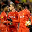 Liverpool's Mario Balotelli (right) speaks with Liverpool's Daniel Sturridge and Liverpool's Jordan Henderson (centre) before taking the penalty during the UEFA Europa League match at Anfield