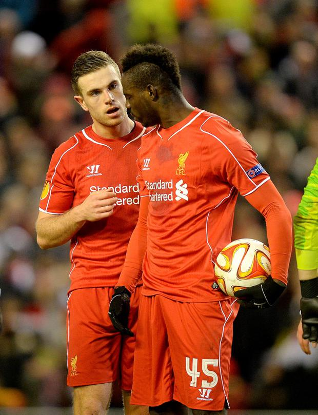 Liverpool's Mario Balotelli (right) speaks with Jordan Henderson before taking the penalty during the UEFA Europa League match at Anfield, Liverpool