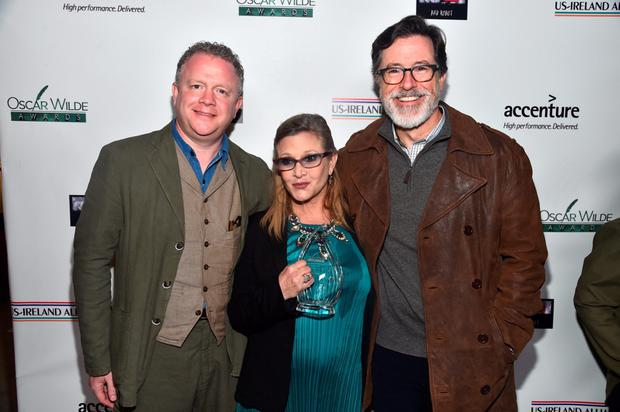 SANTA MONICA, CA - FEBRUARY 19: (L-R) Honorees Colin Davidson, Carrie Fisher and Stephen Colbert attend the US-Ireland Aliiance's Oscar Wilde Awards event at J.J. Abrams' Bad Robot on February 19, 2015 in Santa Monica, California. (Photo by Alberto E. Rodriguez/Getty Images for US-IRELAND ALLIANCE)