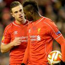Liverpool's Mario Balotelli (right) speaks with Jordan Henderson before taking the penalty during the UEFA Europa League match at Anfield last night