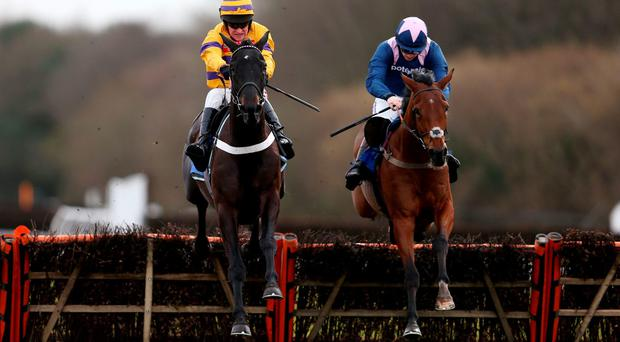 Eventual winner Qualando ridden by Sam Twiston-Davies (right) jumps the last with Gold Present ridden by Barry Geraghty (left) in the Kandy Toys