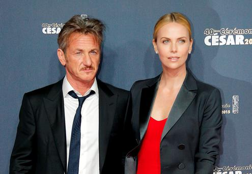 Sean Penn and Charlize Theron arrive at the 40th French Cesar Awards Ceremony in Paris