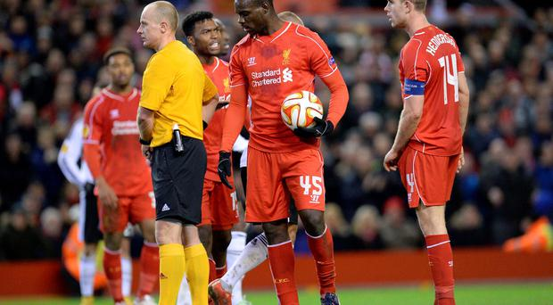 Mario Balotelli gets ready to take Liverpool's penalty on thursday night, as Liverpool's regular penalty taker Jordan Henderson looks on