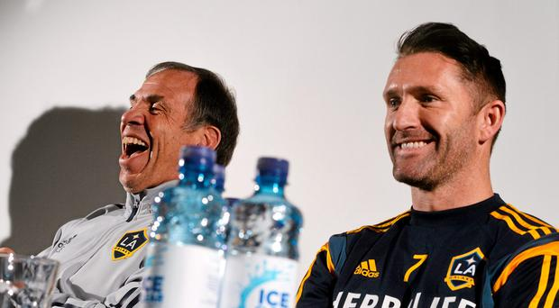 LA Galaxy head coach Bruce Arena and captain Robbie Keane see the funny side of things at yesterday's press conference in Tallaght