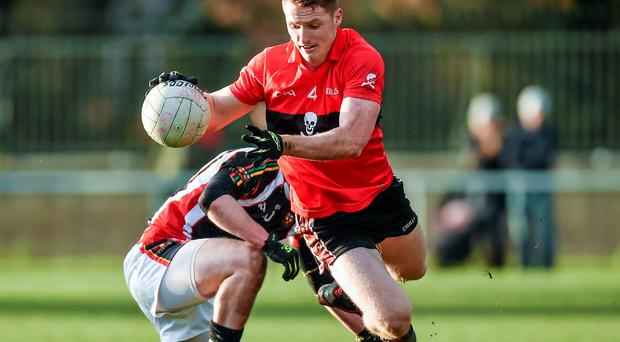 David Culhane, UCC, avoids a tackle from IT Carlow's Marcus Mangan