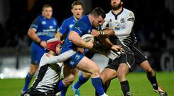 Cian Healy, Leinster, is tackled by, from left, Ruben Riccioli, Dion Berryman and Alberto Chillon, Zebre