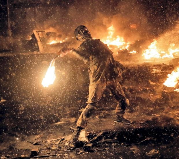 A protester throws a Molotov cocktail during clashes with police in central Kiev, Ukraine on January 22, 2014 during anti-government protests. A year later, so much has changed. Russian president Vladimir Putin has annexed Ukraine's Crimean Peninsula, Ukraine has a new president and government, and the country is in embroiled in a war in the east with Russia-backed separatists