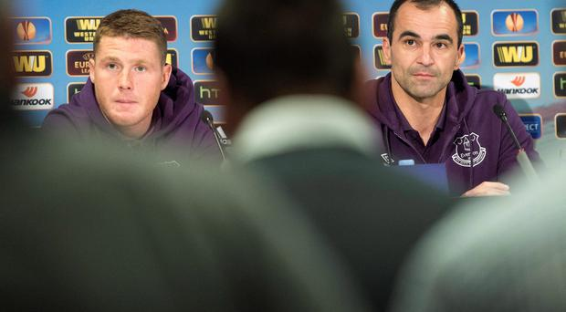 Everton's player James McCarthy, left, and coach Roberto Martinez attend a news conference in Bern, Switzerland, Wednesday, Feb. 18, 2015. FC Everton will face Young Boys Bern in a UEFA Europa League round of 32 soccer first leg soccer match on Thursday. (AP Photo/Keystone,Marcel Bieri)