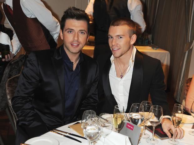 Mark Feehily (L) of Westlife and Kevin McDaid