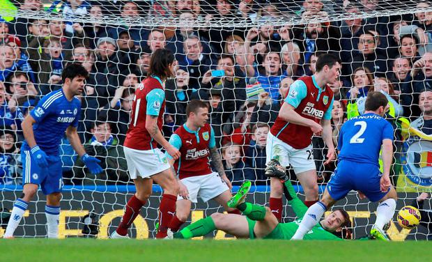 Chelsea's Serbian defender Branislav Ivanovic (R) scores his team's first goal during the English Premier League football match between Chelsea and Burnley at Stamford Bridge in London on February 21, 2015. AFP PHOTO / SEAN DEMPSEY RESTRICTED TO EDITORIAL USE. NO USE WITH UNAUTHORIZED AUDIO, VIDEO, DATA, FIXTURE LISTS, CLUB/LEAGUE LOGOS OR