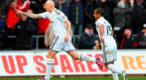 Jonjo Shelvey celebrates scoring their second goal with Wayne Routledge.