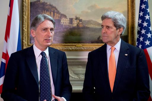 Foreign Secretary Philip Hammond (left) and US Secretary of State John Kerry give a press conference at Carlton Gardens in central London. Photo: Laura Lean/PA