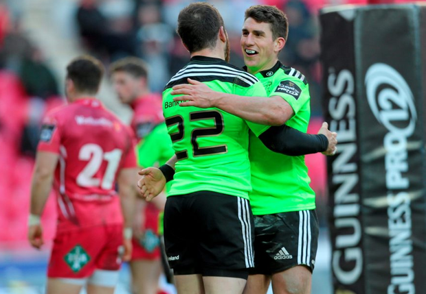 Munster's Ian Keatley congratulates teammate JJ Hanrahan after he scored a late try at Parc Y Scarlets