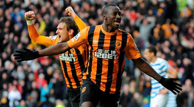 Hull City'ss Dame N'Doyle and Nikica Jelavic celebrate at the KC Stadium