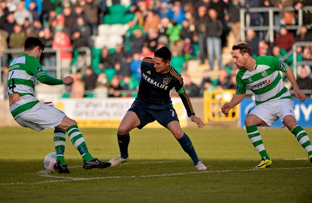 Robbie Keane in action against David O'Connor and David Webster of Shamrock Rovers.