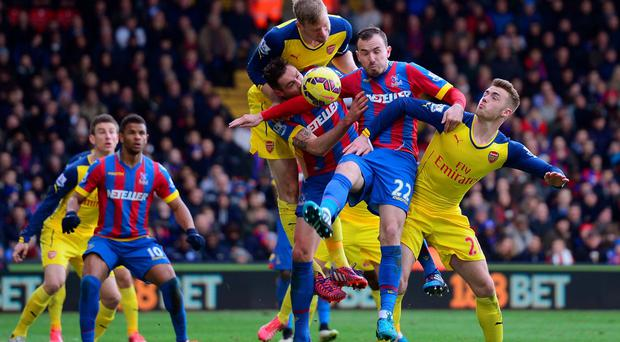 (L-R) Per Mertesacker of Arsenal, Damien Delaney of Crystal Palace, Jordon Mutch of Crystal Palace and Calum Chambers of Arsenal battle for the ball inside the Arsenal box