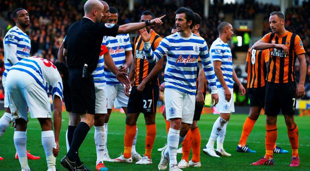 Joey Barton of QPR reacts as he is sent off by referee Anthony Taylor