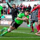 Munster's Felix Jones dives over to score his side's second try of the game