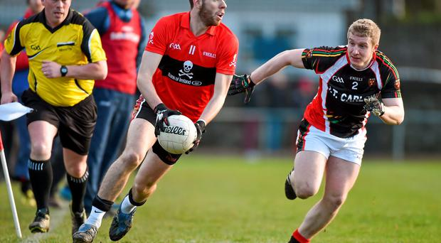 Luke Connolly, UCC, in action against Thomas O'Connell, IT Carlow