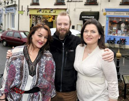 So picturesque: From left, Sandra Archer of Petal & Sand, Dara Macken of the Enniskerry Village Store and Santina Kennedy of Kennedy's Coffee Shop & Bakery. Photo: Gerry Mooney
