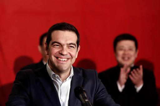 Greek Prime Minister Alexis Tsipras smiles after agreeing a last-minute conditional financial rescue deal with Europe (REUTERS/Alkis Konstantinidis)