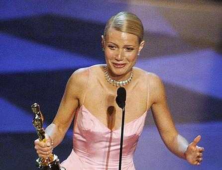 Gwyenth Paltrow holds her Oscar after winning for Best Performance by an Actress in a Leading Role for her part in the movie