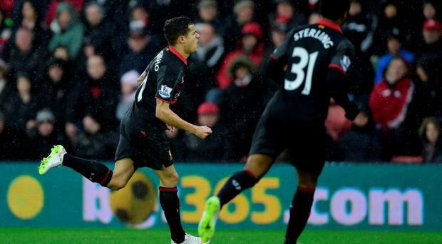 Philippe Coutinho celebrates after scoring against Southampton at St Mary's Stadium.