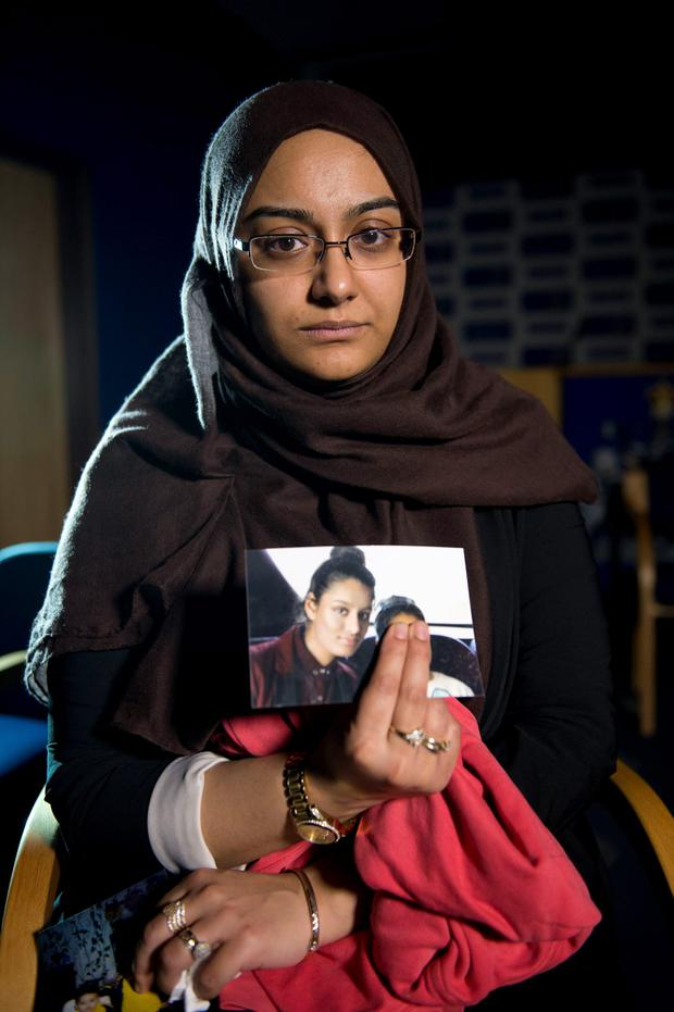 Renu, eldest sister of Shamima Begum, 15, who had fled to Syria, holds her sister's photo. Photo: Laura Lean/PA Wire