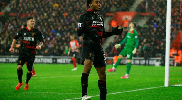 Raheem Sterling celebrates after scoring his team's second goal at St Mary's Stadium