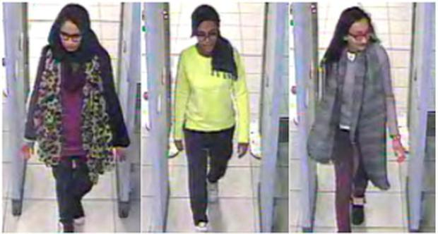 British teenage girls Shamima Begun, Amira Abase and Kadiza Sultana (L-R) walk through security at Gatwick airport before they boarded a flight to Turkey on February 17, 2015, in this combination picture made from handout still images taken from CCTV and released by the Metropolitan Police. REUTERS/Metropolitan Police/Handout