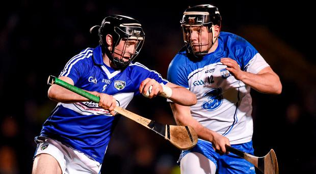 Paddy Purcell, Laois, in action against Jake Dillon, Waterford