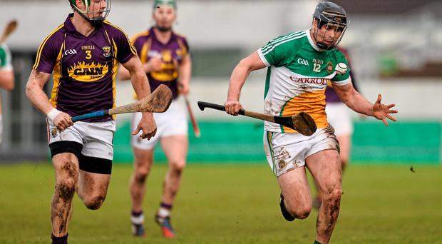 Dan Currams, Offaly, in action against Matthew O'Hanlon, Wexford